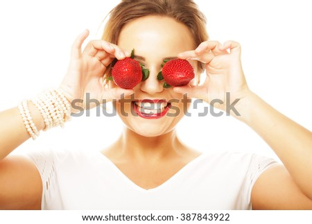 Fun woman with strawberry  - stock photo