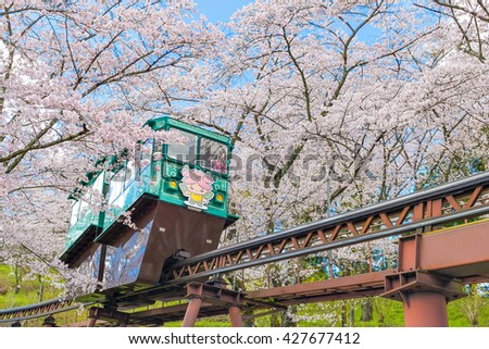 FUNAOKA CASTLE RUINS PARK - APRIL 10 : Many Tourists transport with tram to uphill on APRIL 10, 2016 at funaoka castle ruins park in cherry blossom festival 2016.