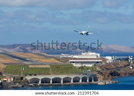 FUNCHAL, PORTUGAL - AUG 12: A Boeing 737 from Dutch airline Transavia is approaching Funchal Airport on Augustus 12, 2014 at Madeira, Portugal - stock photo