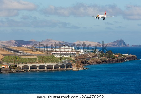 FUNCHAL, PORTUGAL - AUG 12: A Boeing 737 from Portugese airline TAP is approaching Funchal Airport on Augustus 12, 2014 at Madeira, Portugal - stock photo