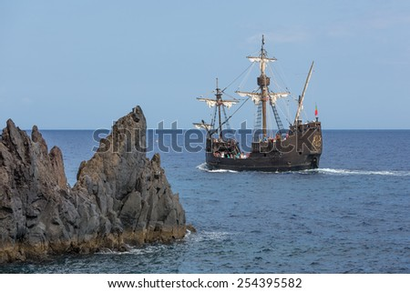 """FUNCHAL, PORTUGAL - AUG 03: Tourists making a cruise with a replica of vessel """"Santa Maria"""" of Columbus near Funchal on Augustus 03, 2014 at Madeira Island, Portugal - stock photo"""