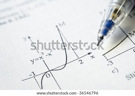 Function graph from a math book with a pencil - stock photo