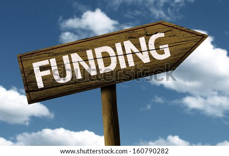 Funding creative sign with clouds as the background - stock photo