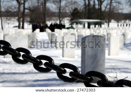 Funeral behind a heavy chain at the Arlington National Cemetery in Virginia - stock photo