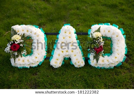 funeral flowers in the name of dad - stock photo