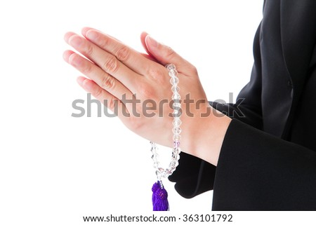 Funeral mourning woman hands in prayer rosary - stock photo