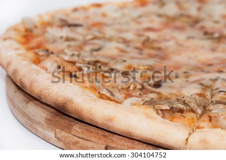 Fungi pizza on the wooden board. - stock photo