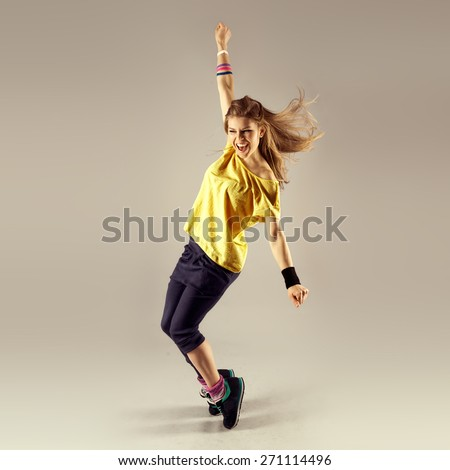 Funk dance workout. Portrait of young sporty woman in motion. Zumba - stock photo