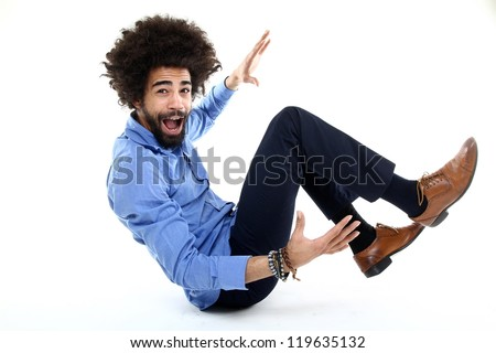 Funky Afro man sitting - stock photo