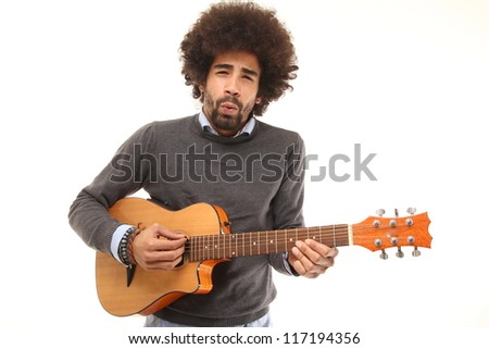 funky afro man with a guitar - stock photo