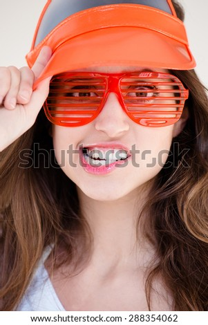 Funky Fashion Model in Orange Visor