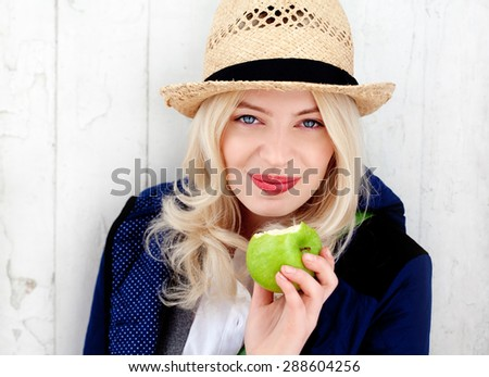 Funky healthy girl eating apple - stock photo