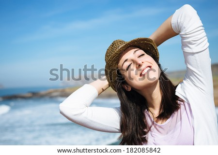 Funky woman on coast spring travel relaxing and enjoying peace and tranquility. - stock photo