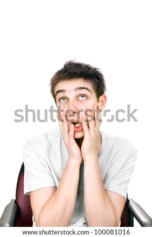 funny and amazed young man isolated on the white background