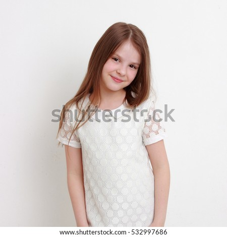 Funny and cheerful teen girl as a fashion model