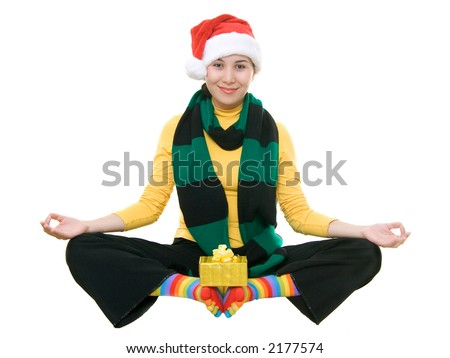Funny asian girl in santa's hat meditating, isolated on white - stock photo