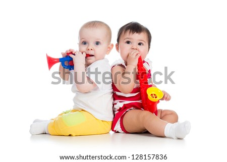 Funny babies girls  with musical toys. Isolated on white background - stock photo