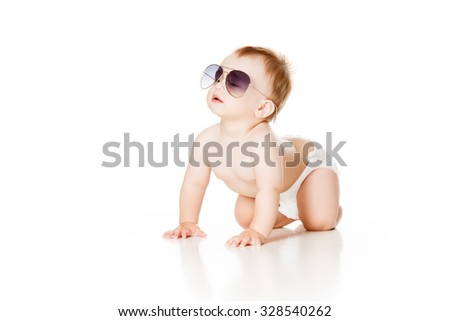 funny baby boy crawling in sunglasses on white background - stock photo