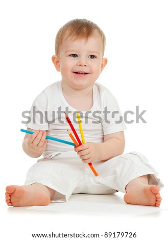funny baby boy drawing with color pencils - stock photo