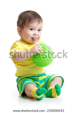 funny baby boy playing with massage ball - stock photo