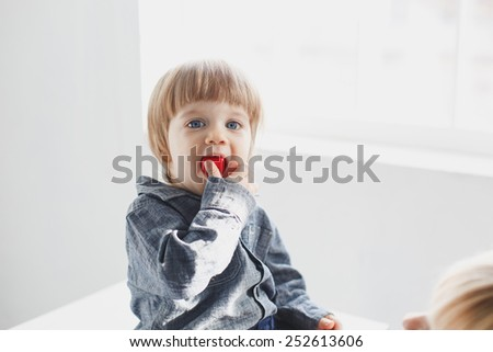 funny baby boy with a toy in the mouth
