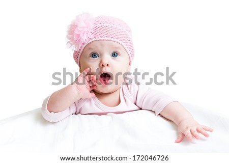 funny baby girl lying on white - stock photo