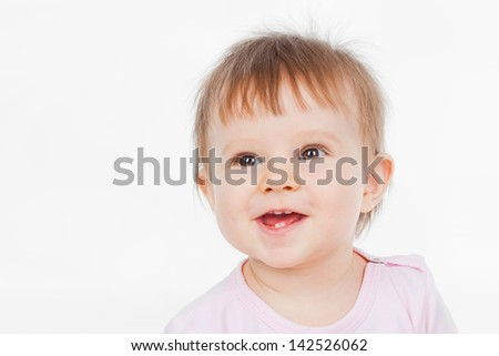 Funny baby, on a gray background
