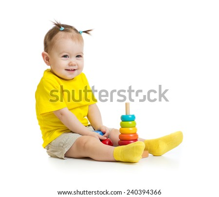 funny baby playing with colorful wood pyramid isolated - stock photo