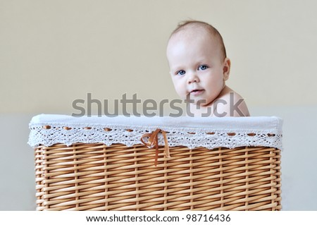 funny baby sitting in the basket