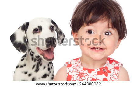 Funny baby with a beautiful dalmatian dog isolated on a white background - stock photo