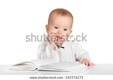 funny baby with glasses reading a book isolated on white background - stock photo