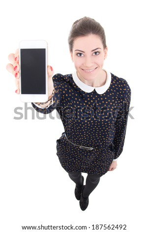 funny beautiful business woman showing mobile phone with blank screen isolated on white background - stock photo