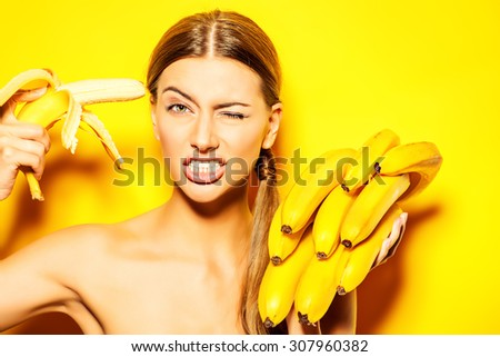Funny beautiful young woman with bananas. Tropical fruits. Summer concept. Healthy eating. - stock photo