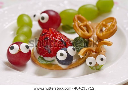 Funny beetles from grapes and berries - stock photo
