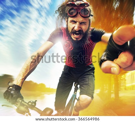Funny bicyclist riding a bike - stock photo