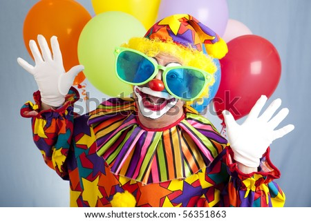 Funny birthday clown in hilarious oversized sunglasses. - stock photo