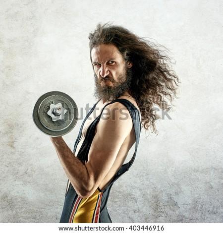 Funny bodybuilder - stock photo