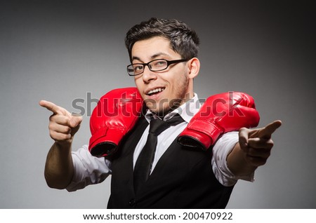 Funny boxer businessman in sport concept