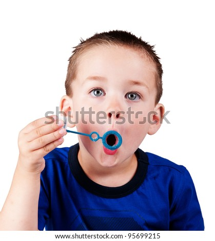 funny boy blowing bubbles isolated - stock photo