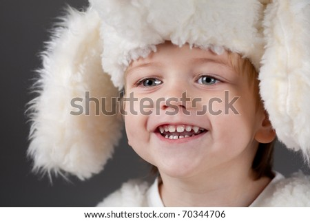 funny boy in fur hat - stock photo