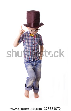 funny boy of five years in the cylinder hat on a white background