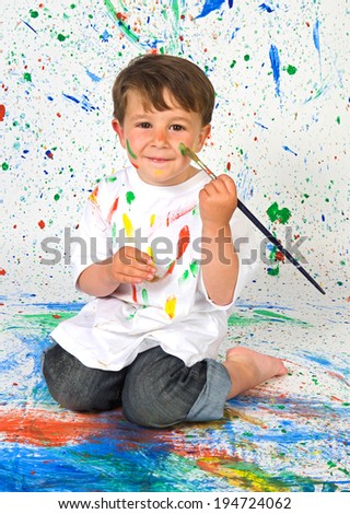 Funny boy painting isolated on a white background - stock photo