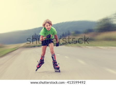 Funny Boy rollerblading on the road . - stock photo