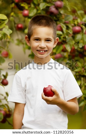 funny boy with apple - stock photo