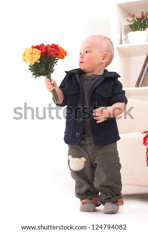 funny boy with bunch of flowers - stock photo