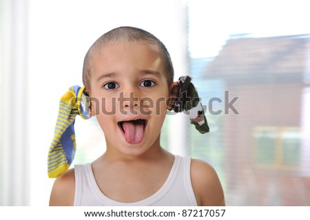 Funny boy with socks on ears :) - stock photo