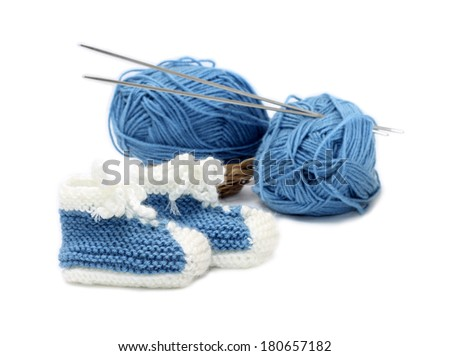 Funny boys' booties with yarn, isolated on white background - stock photo