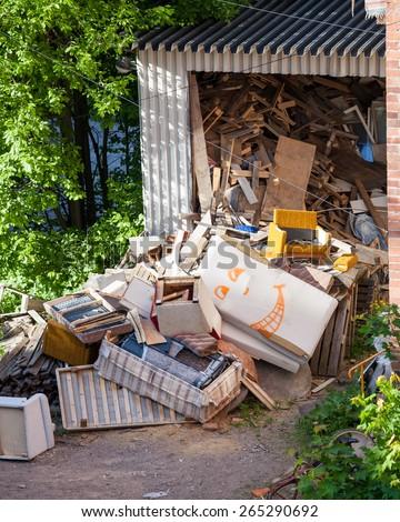 Funny broken furnitures trash pile - stock photo