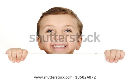 Funny brown hair blue eyes child smile and holding a banner on white - stock photo