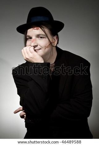 Funny bum in hat with scar on his face - stock photo